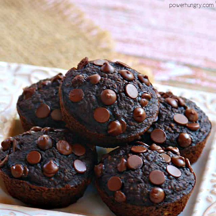 vegan chocolate oat muffins piled on a small white square plate