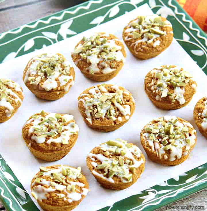 a batch of vegan pumpkin latte blender muffins on a green and white plate