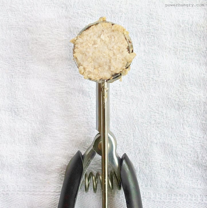 cookie scoop filled with cookie dough, on a white background