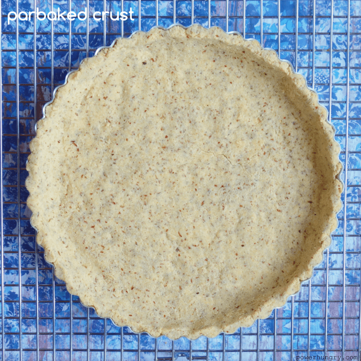 parbaked coconut flour-almond flour pie crust on a cooling rack