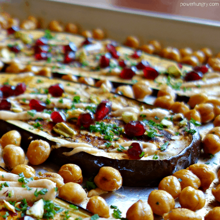 close up of roasted eggplant and chickpeas with Middle Eastern toppings