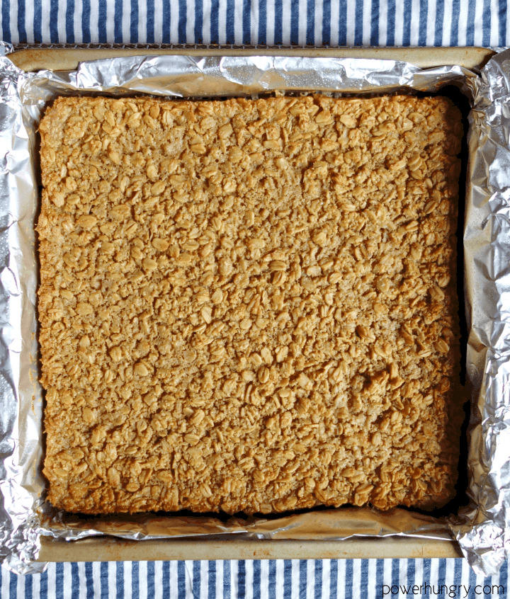 baked Coconut Baked Oatmeal Squares in a foil-lined pan, uncut