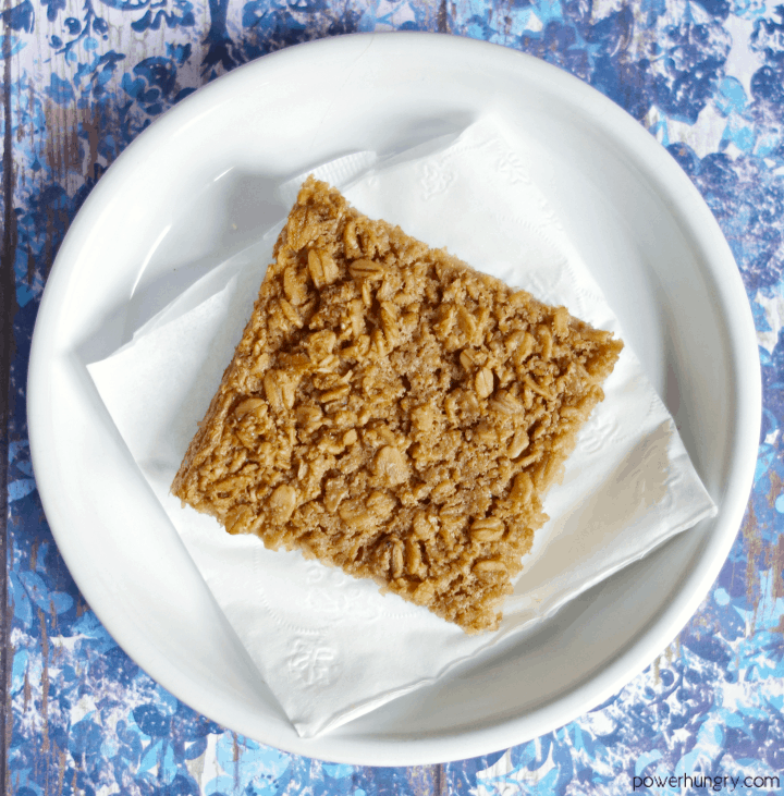 3-Ingredient Coconut Baked Oatmeal Square on a white plate with blue background