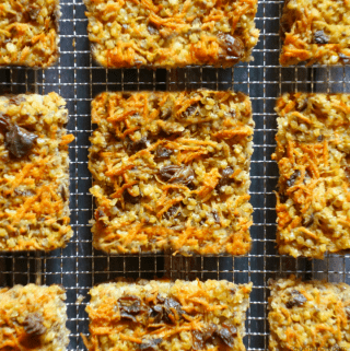 carrot cake millet bars, cut into squares and placed on a wire rack
