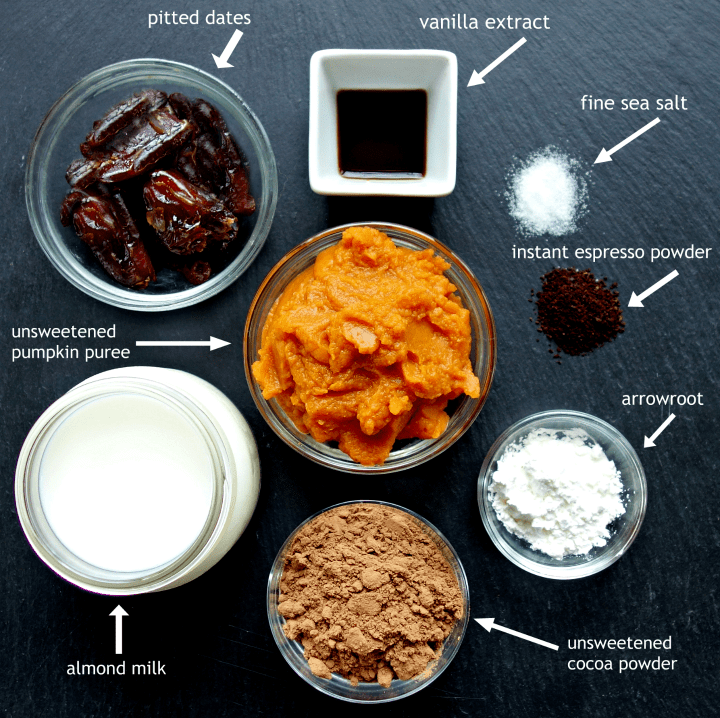 ingredients for chocolate pumpkin pudding cups on a piece of slate