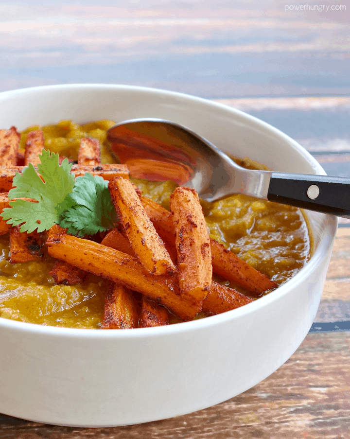 Moroccan Lentils on Turmeric Roasted Carrots in a white bowl