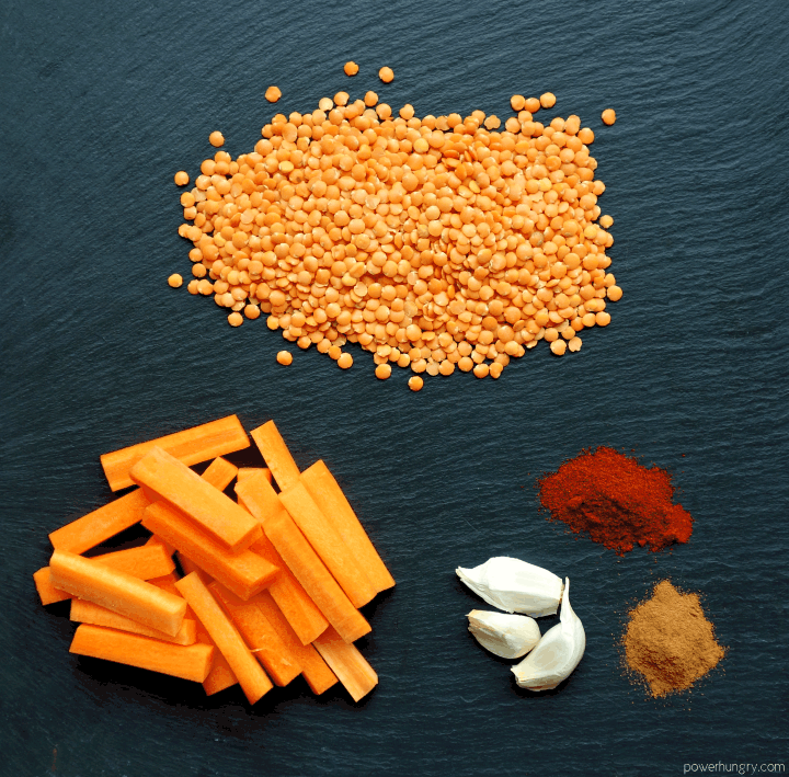 ingredients for Moroccan Lentils & Roasted Carrots on black slate