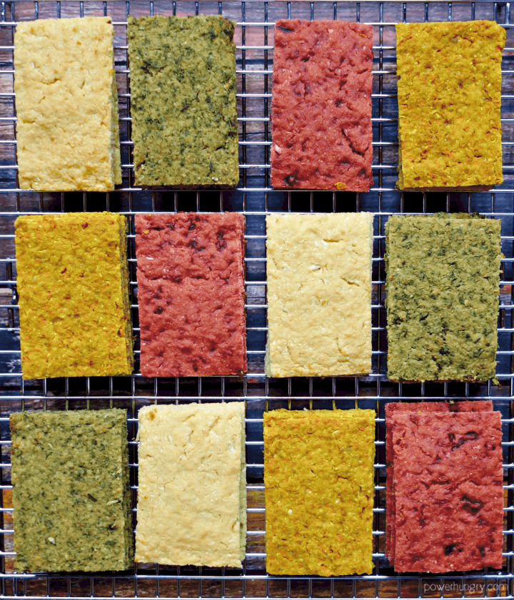 overhead shot of assorted 3-ingredient chickpea flour vegetable flatbread on a cooling rack