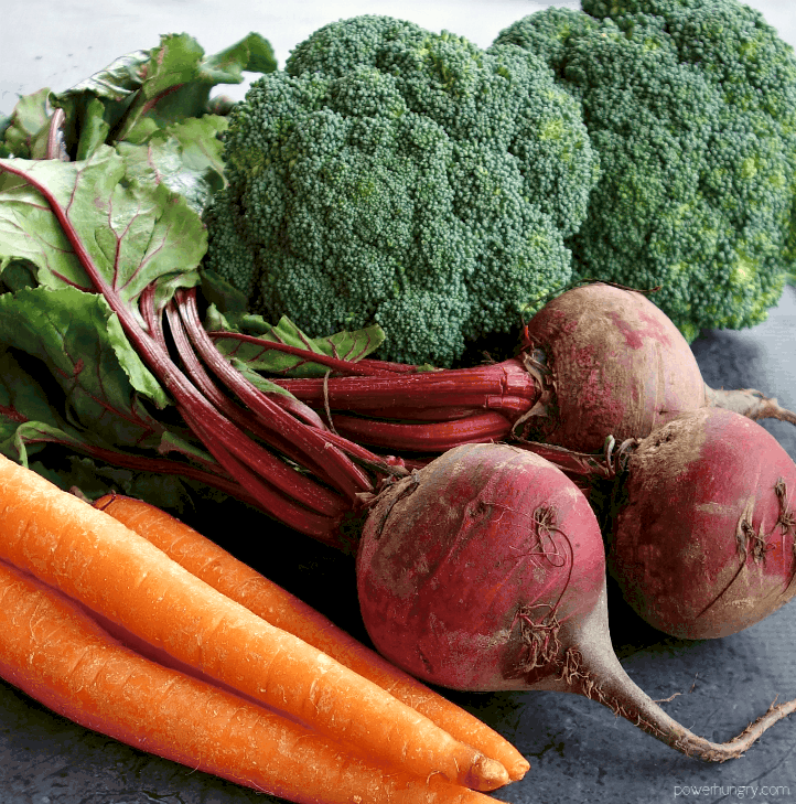 close up of carrots, beets, and broccoli