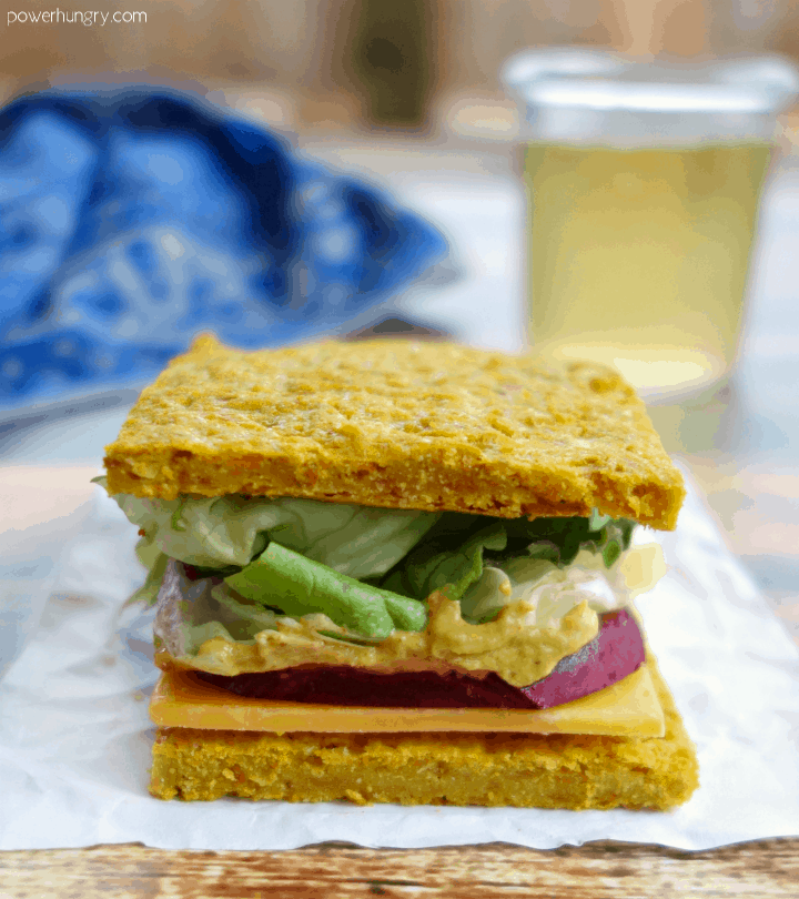 vegan sandwich made with carrot chickpea flour flatbread
