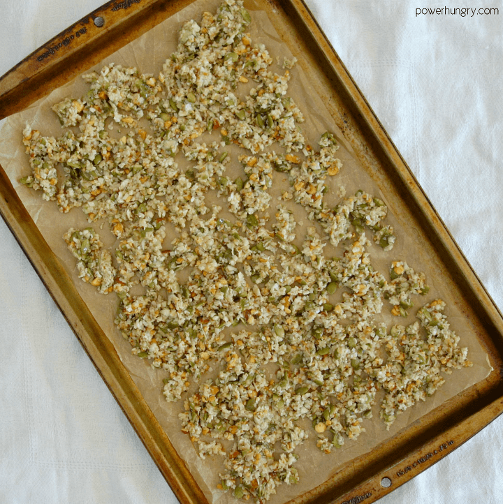 unbaked grain-free granola on a parchment paper-lined baking sheet