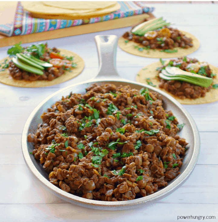 Vegan Lentil Taco Meat in a sillet with more behind.