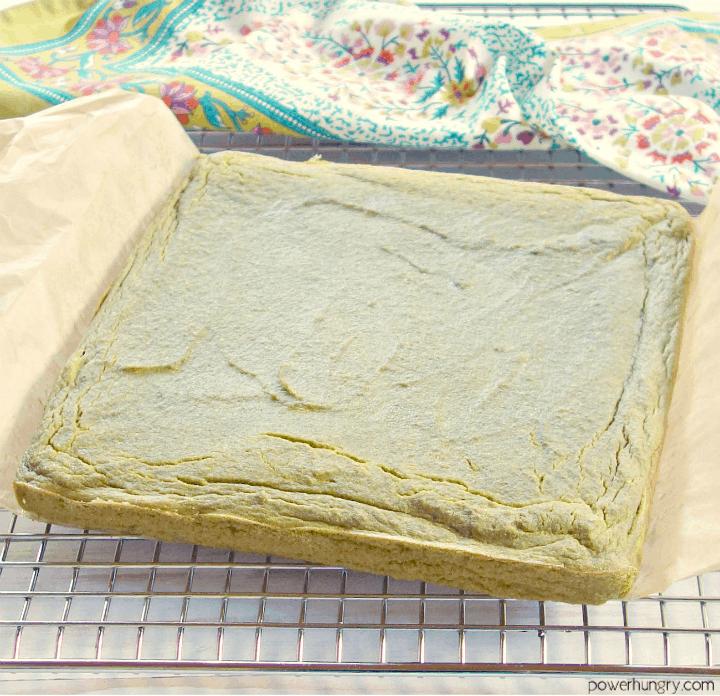 freshly baked fresh herb lentil bread on a cooling rack, uncut