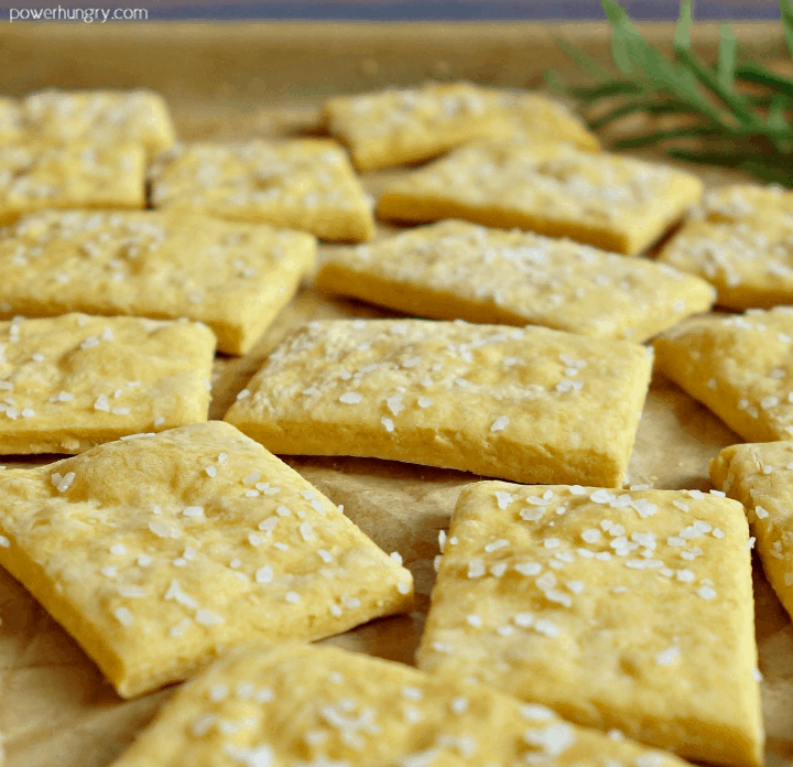 close-up of chickpea flour crackers on a parchment paper -line baking pan