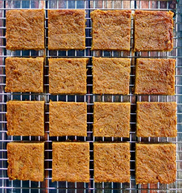 overhead shot of 16 coconut flour pumpkin pie bars cut into squares
