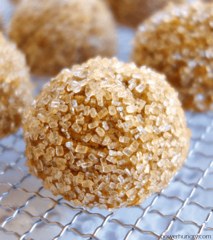 close up of a pumpkin almond flour cookie on a wire cooling rack