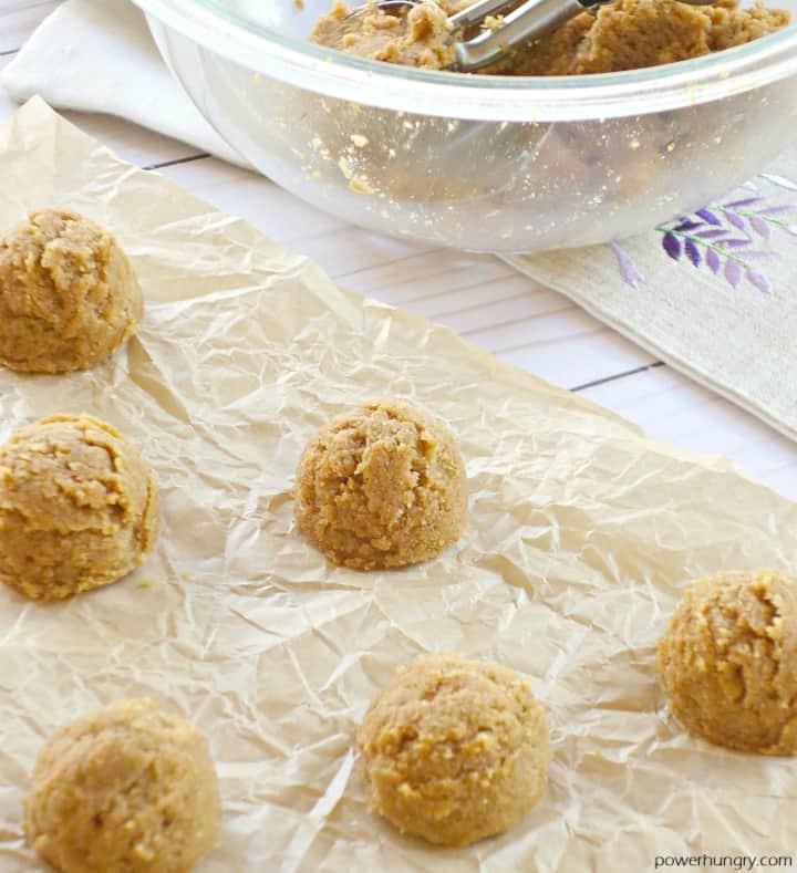 unbaked dough mounds of pumpkin almond vegan cookies