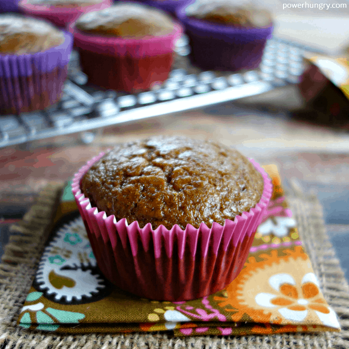 gingerbread chickpea flour muffin on a colorful fall napking, with more muffins in the background