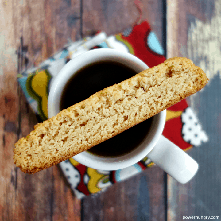 4-Ingredient Vegan Almond Flour Biscotti perched on top of a cup of espresso