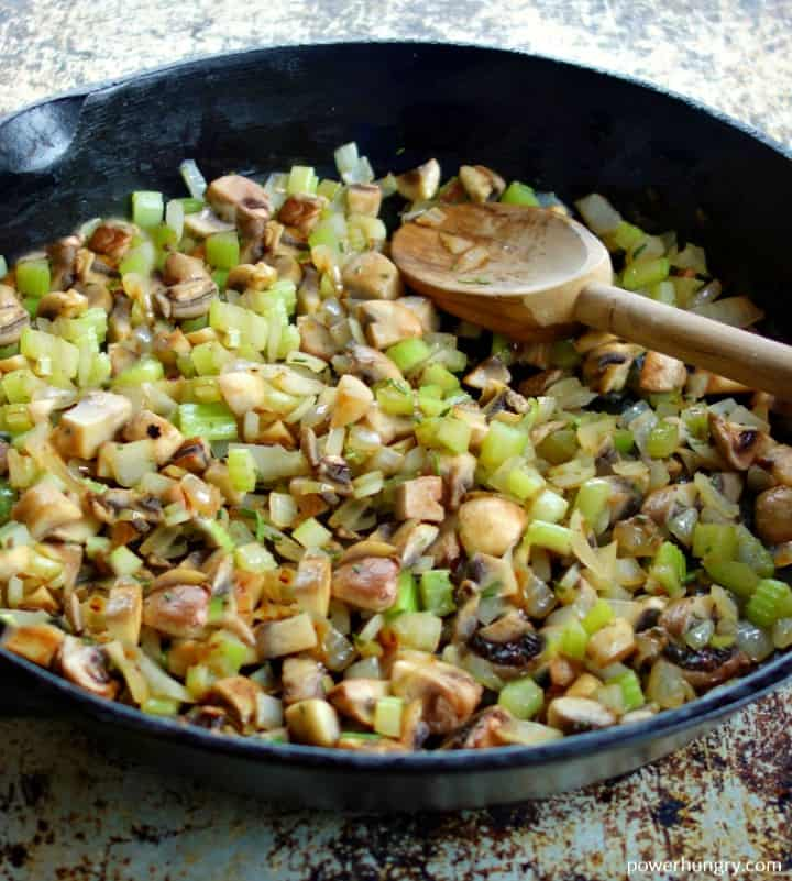 sautéed onions mushrooms and celery in a cast iron skillet