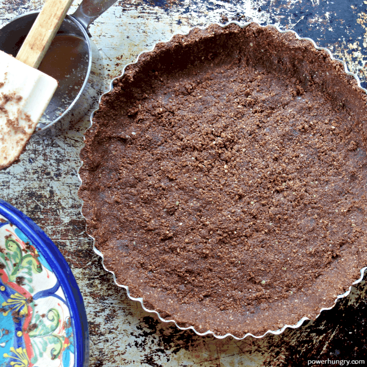 overhead shot of almond flour chocolate crust in a tart pan