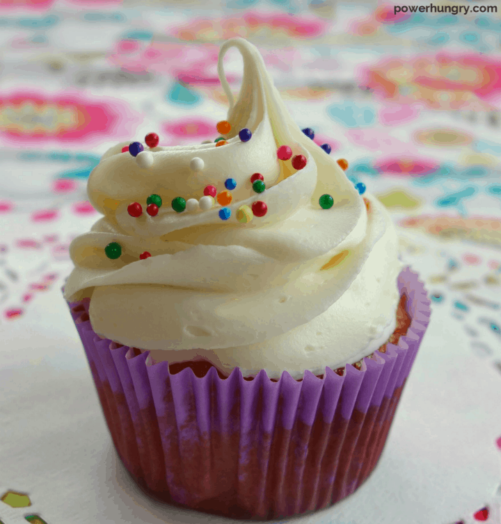 close up of cupcake frosted with vegan vanilla buttercream frosting