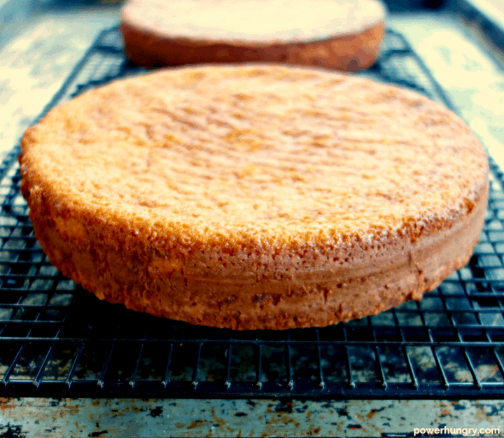 grain-free and vegan vanilla cakes layers on a black cooling rack