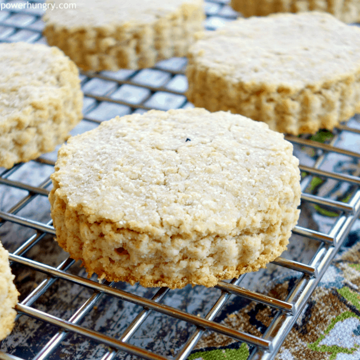 Oat and coconut flour vegan biscuits on a wire cooling rack with colorful napkin