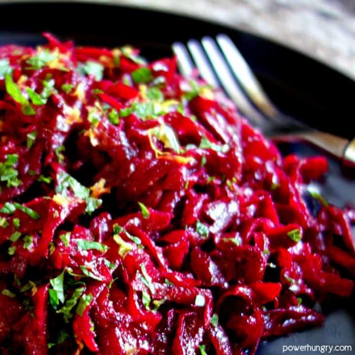 close-up of fresh beet salad with lemon & mint on a slate plate with a fork alongside