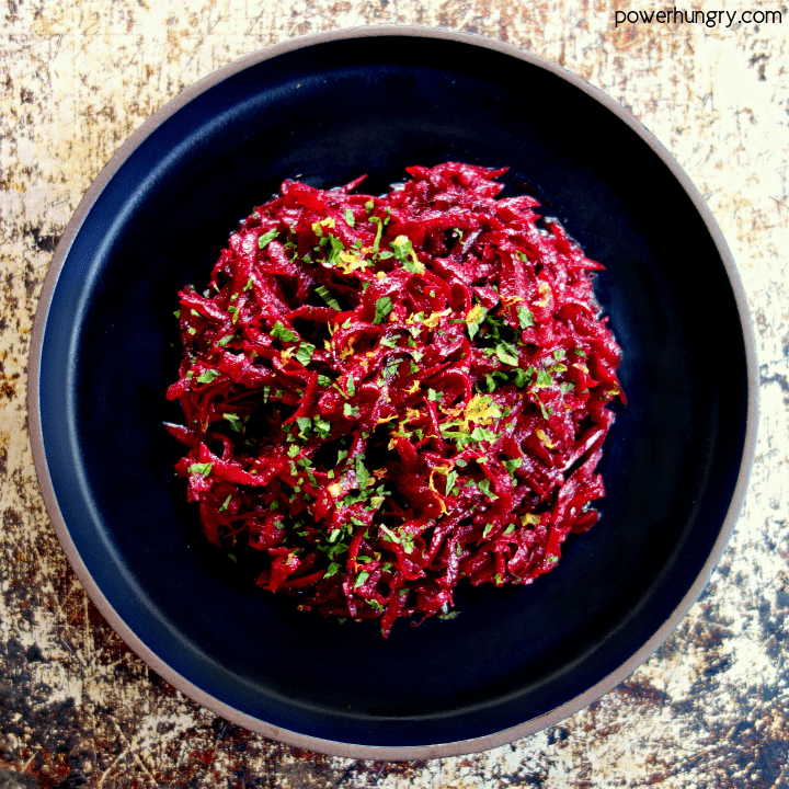 overhead shot of fresh beet salad on a slate plate