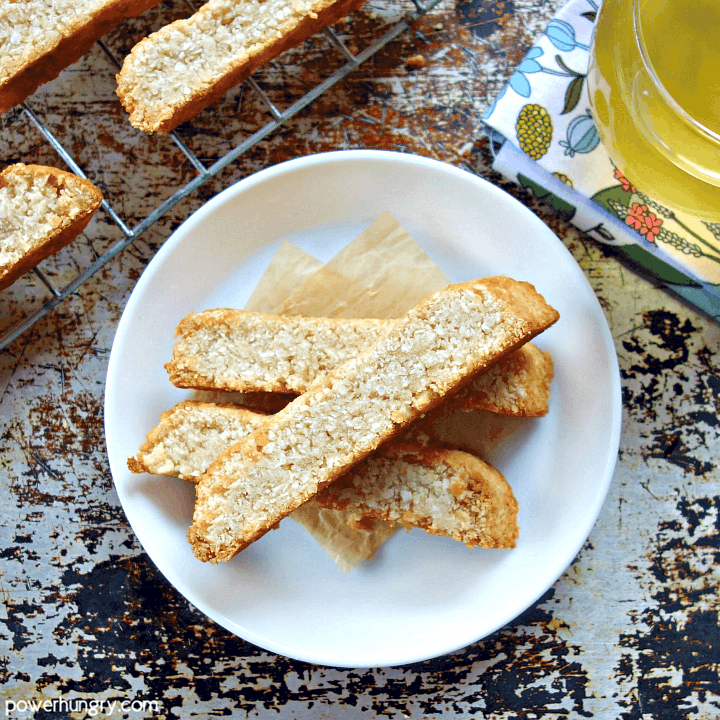 2-ingredient coconut biscotti stacked on a white plate