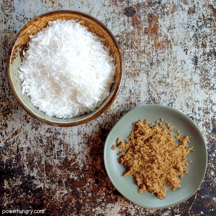 The 2 ingredients for coconut biscotti, unsweetened coconut flakes an coconut sugar