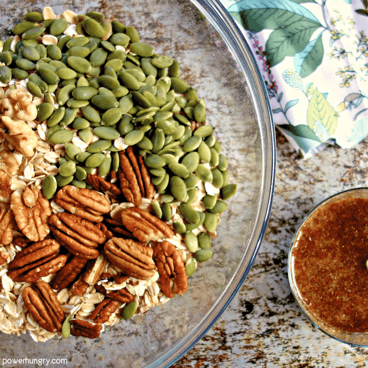 dry ingredients and wet ingredients for oil free granola in separate bowls
