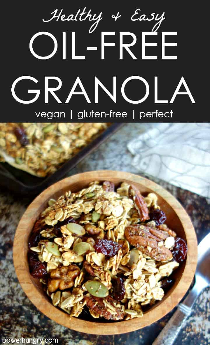 healthy oil-free granola in a wooden bowl with sheet pan of granola and napkin in background