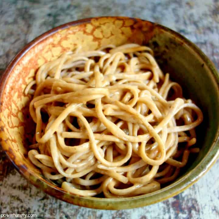 small bowl of buckwheat soba noodles with tahini sauce