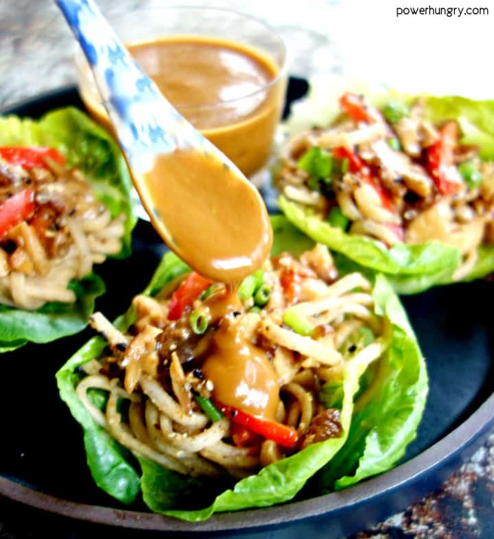noodle lettuce cup being drizzled with tahini sauce