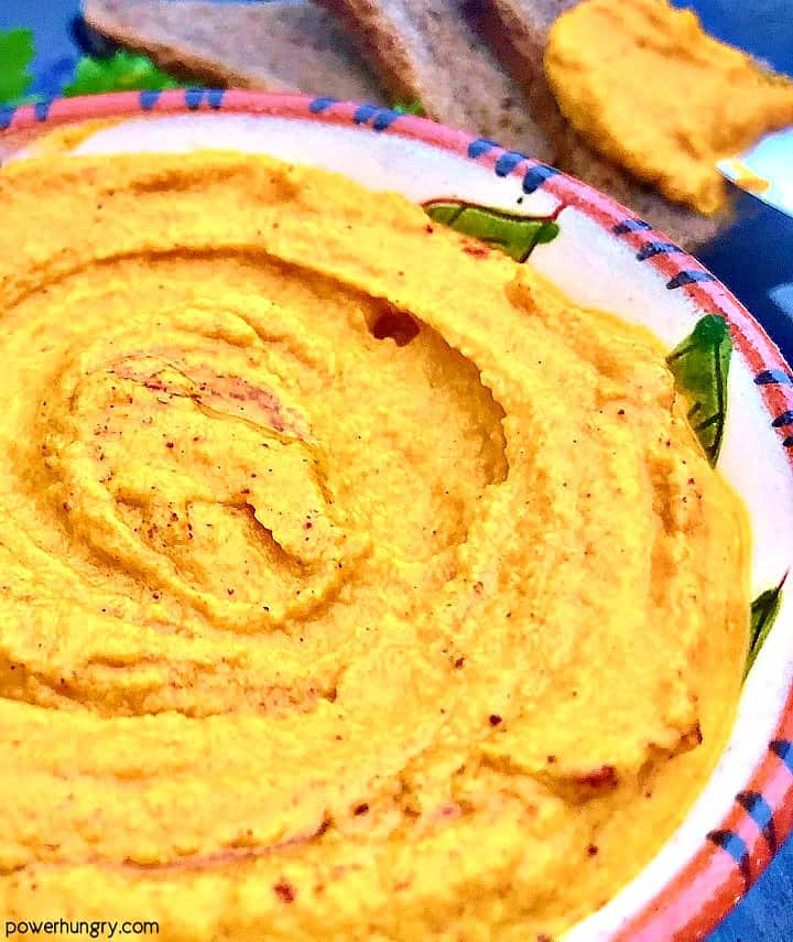 close-up of oil-free roasted carrot hummus
