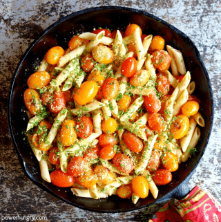 Cast iron skillet filled with chickpea cherry tomato pasta