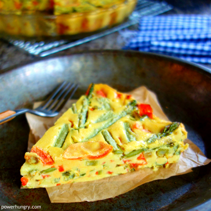 slice of chickpea flour frittata in a metal dish