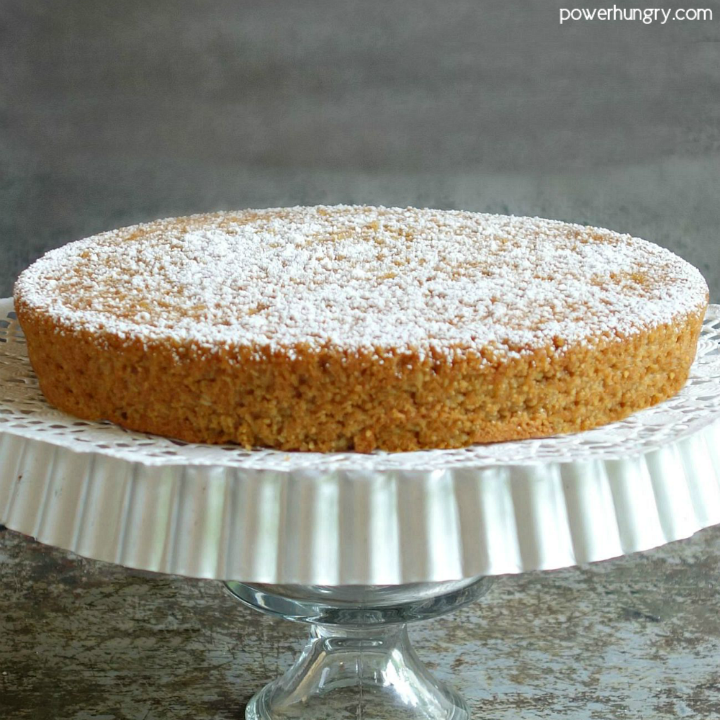 vegan almond flour cake on a cake stand