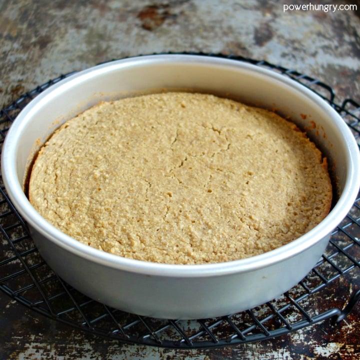 vegan almond flour cake in pan on cooling rack