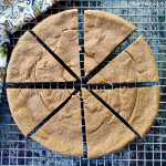 overhead shot of sliced 2-ingredient lentil flax bread on wire cooling rack