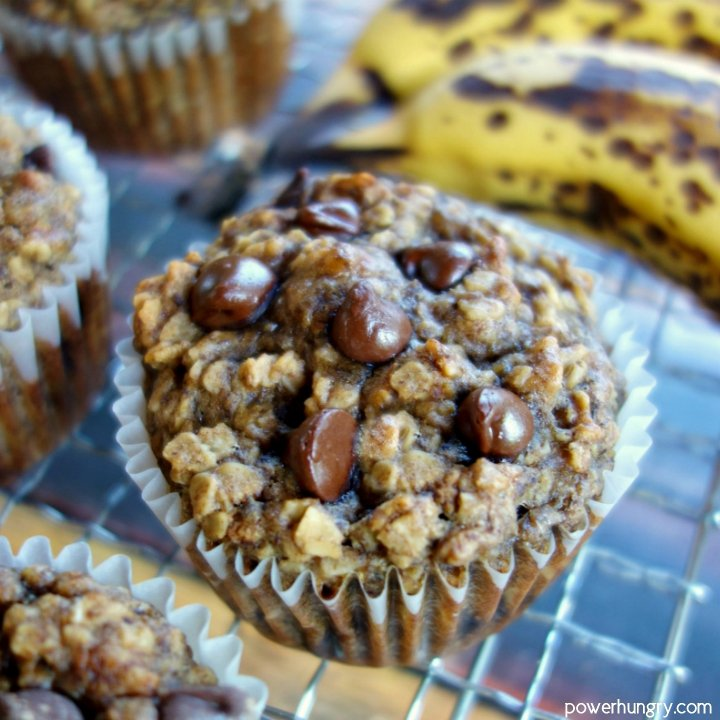 Peanut Butter Banana Baked Oatmeal Cups on a wire cooling rack with bananas in background