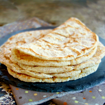 stack of 2 ingredient Coconut Flour Tortillas on a slate plate