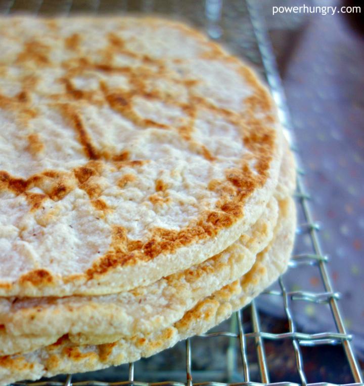Stack of vegan Coconut Flour Tortillas on a cooling rack