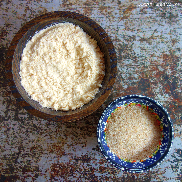 2 small decorative bowls, one filled with coconut flour, the other, psyllium husk
