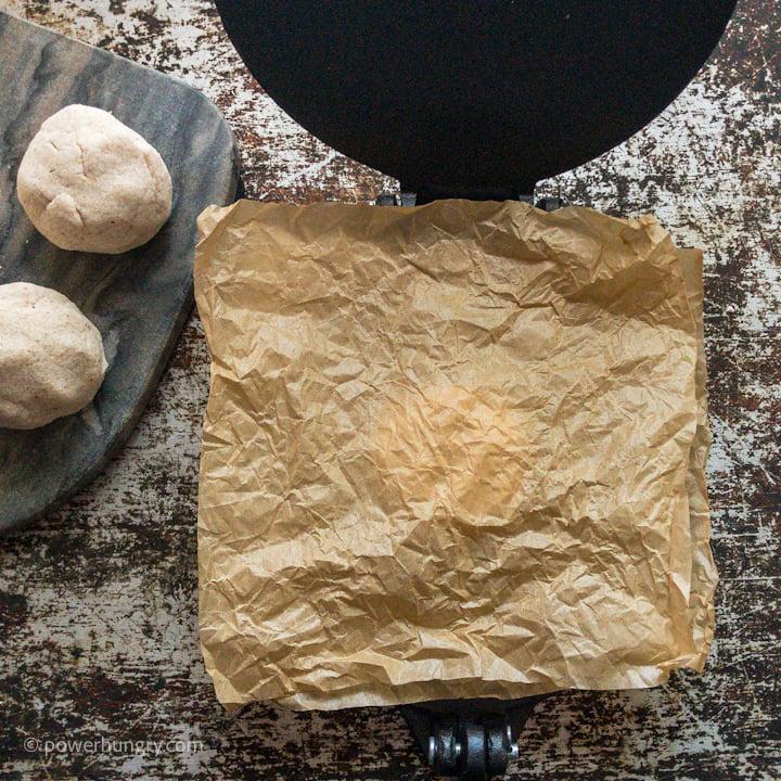 cassava flour tortilla being made in a tortilla press