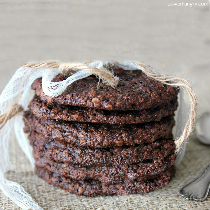 stack of double chocolate oat cookies that are vegan and gluten-free on a piece of brown burlap
