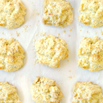 overhead shot of irish soda bread biscuits on a parchment lined baking sheet