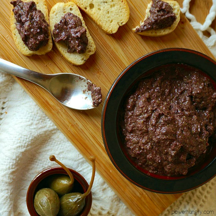 overhead shot of tapenade and toasts with tapenade